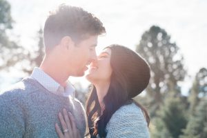 An Image from a Romantic Engagement Session at a Christmas Tree Farm in Alpine, Utah